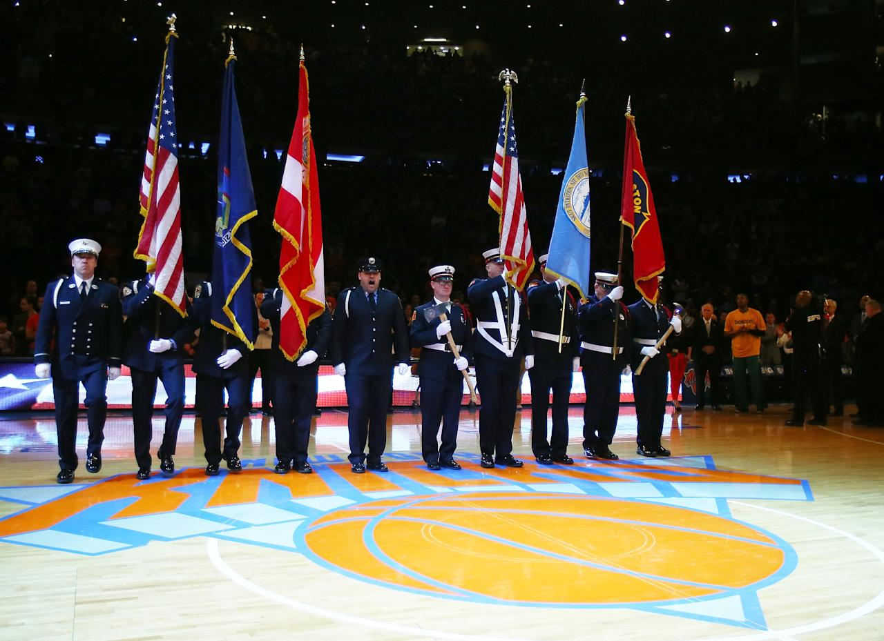 NEW YORK, NY - APRIL 20:  First responders from Boston present the colors before Game One of the Eastern Conference Quarterfinals of the 2013 NBA Playoffs between the Boston Celtics and the New York Knicks on April 20, 2013 at Madison Square Garden in New York City. NOTE TO USER: User expressly acknowledges and agrees that, by downloading and/or using this photograph, user is consenting to the terms and conditions of the Getty Images License Agreement.  (Photo by Elsa/Getty Images)