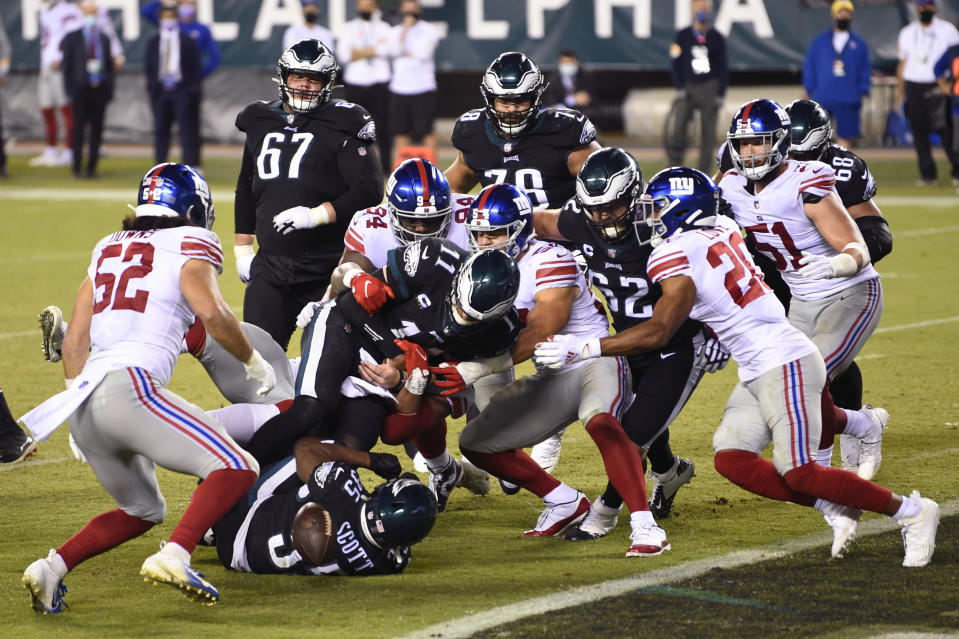 Philadelphia Eagles' Carson Wentz (11) cannot score on a two-point conversion attempt during the second half of an NFL football game against the New York Giants, Thursday, Oct. 22, 2020, in Philadelphia. (AP Photo/Derik Hamilton)