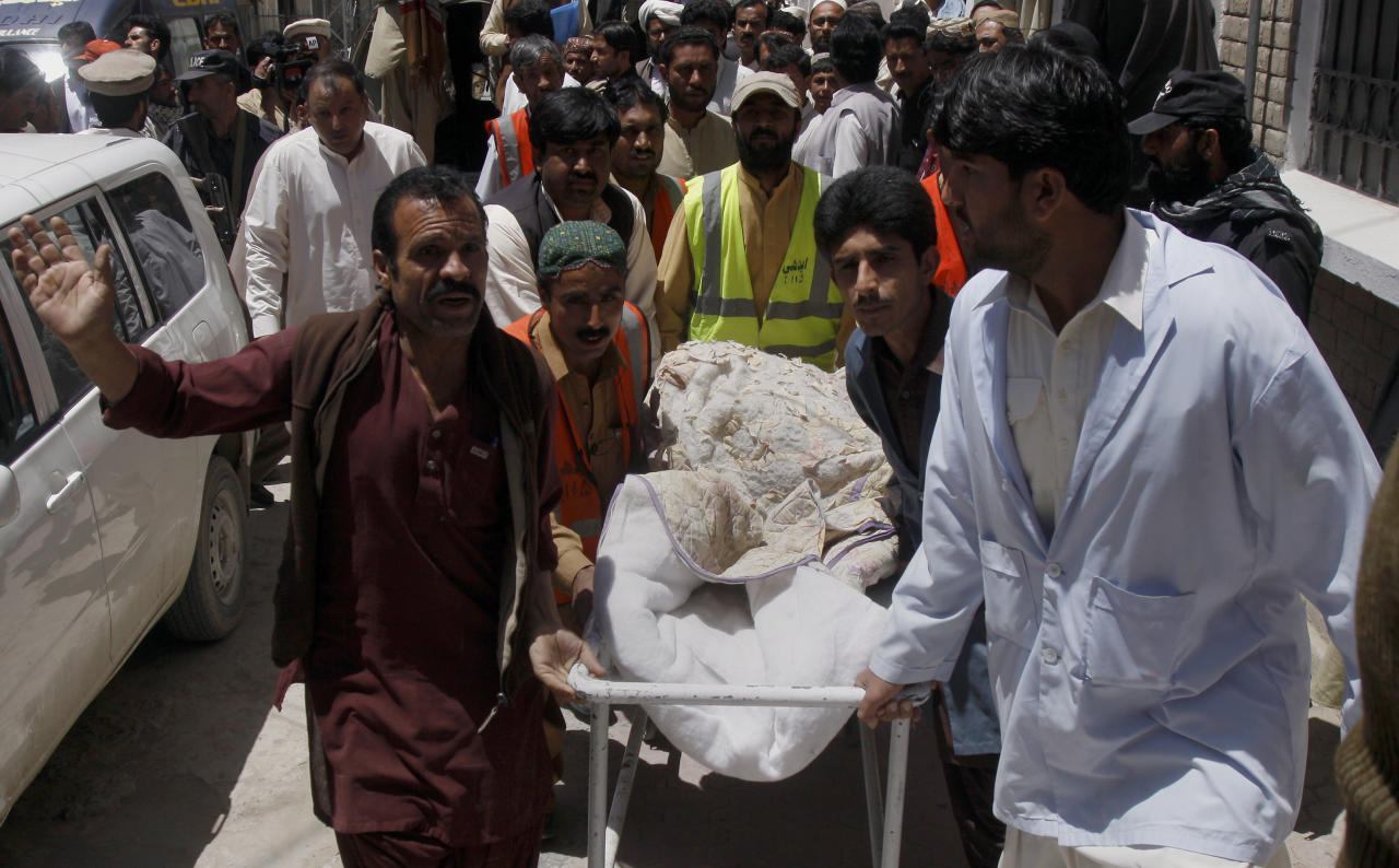 Pakistani volunteers and hospital staff transport the body of British Red Cross worker Khalil Rasjed Dale at a local hospital in Quetta, Pakistan on Sunday, April 29, 2012. The body of a British Red Cross worker held captive in Pakistan since January was found in an orchard Sunday, his throat slit and a note attached to his body saying he was killed because no ransom was paid, police said. (AP Photo/Arshad Butt)
