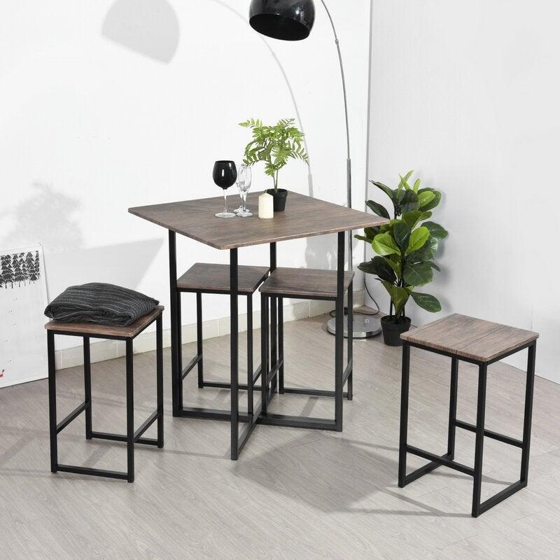 """<br><br><strong>Joss and Main</strong> Malave 5 Piece Counter Height Dining Set, $, available at <a href=""""https://go.skimresources.com/?id=30283X879131&url=https%3A%2F%2Ffave.co%2F35Y0U9F"""" rel=""""nofollow noopener"""" target=""""_blank"""" data-ylk=""""slk:Joss and Main"""" class=""""link rapid-noclick-resp"""">Joss and Main</a>"""