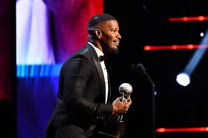 "Jamie Foxx accepts Outstanding Supporting Actor in a Motion Picture for ""Just Mercy"" at the 51st NAACP Image Awards on February 22, 2020. (Photo by Paras Griffin/Getty Images for BET)"