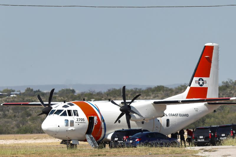 People board an U.S. Coast Guard airplane at the Del Rio International Airport as U.S. authorities accelerate removal of migrants at border with Mexico, in Del Rio