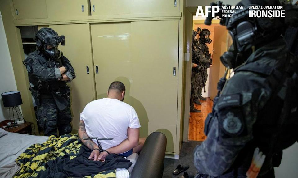 A person is detained by Australian federal police after its operation against organised crime