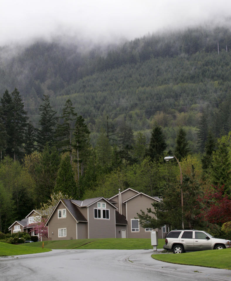 Homes in a woodsy suburb are seen adjacent to a wilderness area and nearby trail access several miles from where a gun-toting survivalist is suspected of killing his wife and daughter several days earlier Friday, April 27, 2012, in North Bend, Wash. Peter Alex Keller may be holed up in a self-made fort not far from where Seattle's outer suburbs give way to the vast recreational playground of Cascade Mountains. Police expect more people to hit the nearby trails this weekend, and deputies are warning them to steer clear of Keller if they think they see him. (AP Photo/Elaine Thompson)