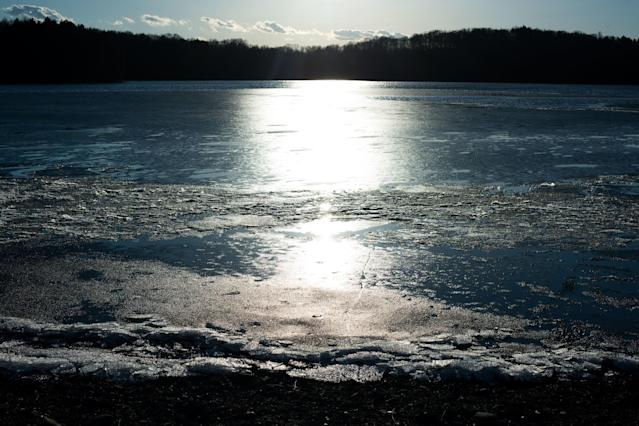 The sun shines across the water of the Lake Washington reservoir in Newburgh, New York. (Mark Kauzlarich for HuffPost)