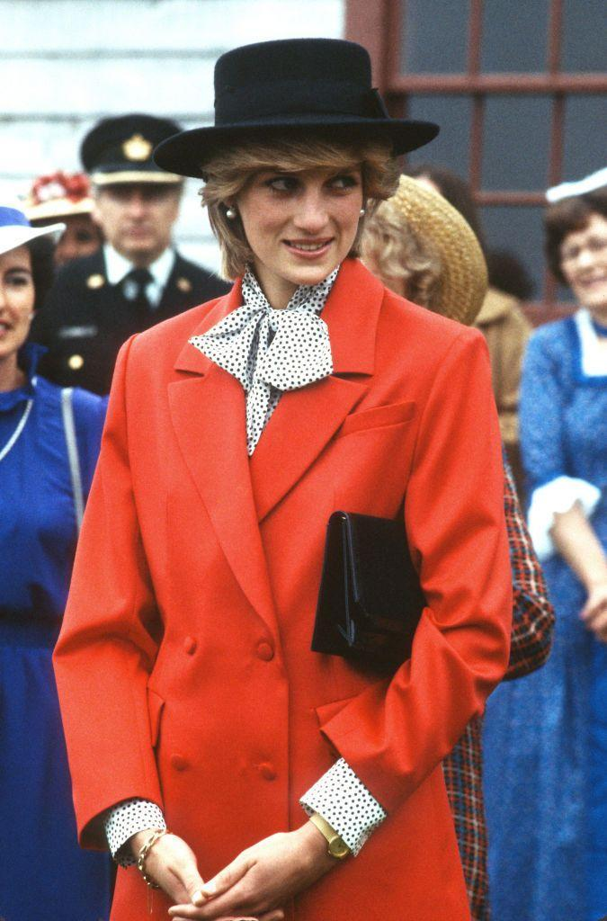 <p>This look was all about statement details: Princess Diana paired the bright red blazer with a polka dot blouse and a black hat. She wore this ensemble during a royal tour of Canada in June 1983.<br></p>