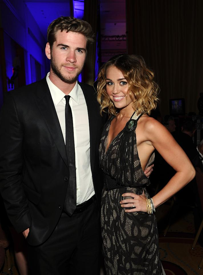 PHOENIX, AZ - FILE:  Actress/singer Miley Cyrus and Liam Hemsworth backstage during Muhammad Ali's Celebrity Fight Night XIII held at JW Marriott Desert Ridge Resort & Spa on March 24, 2012 in Phoenix, Arizona. The couple are engaged to be married as confirmed by their reps on June 6, 2012.  (Photo by Michael Buckner/Getty Images for CFN)