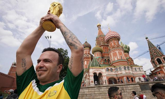 "<span class=""element-image__caption"">An Australian fan holds his own World Cup trophy in the air in Moscow's Red Square.</span> <span class=""element-image__credit"">Photograph: Christopher Furlong/Getty Images</span>"