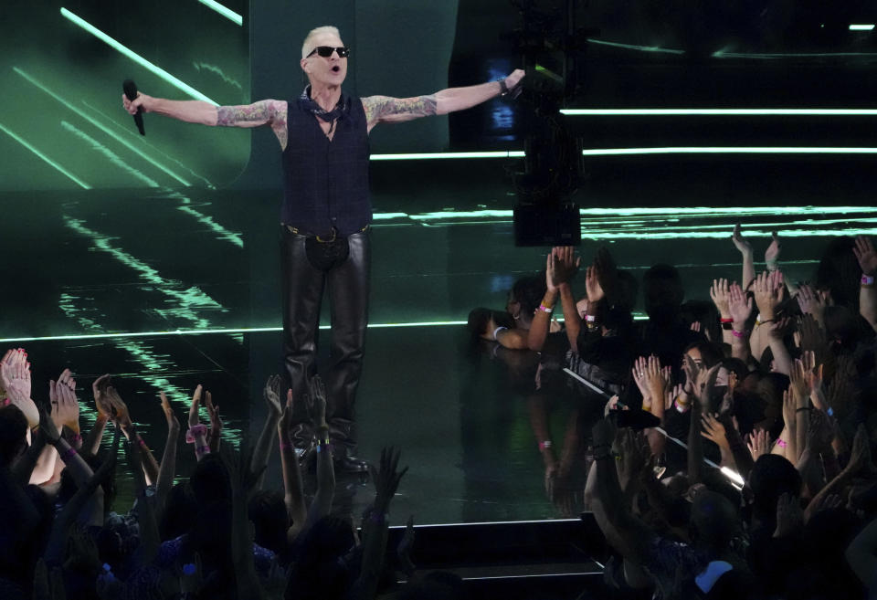 FILE - David Lee Roth presents the award for video of the year at the MTV Video Music Awards on Sept. 12, 2021, in New York. Roth turns 67 on Oct. 10. (Photo by Charles Sykes/Invision/AP, File)