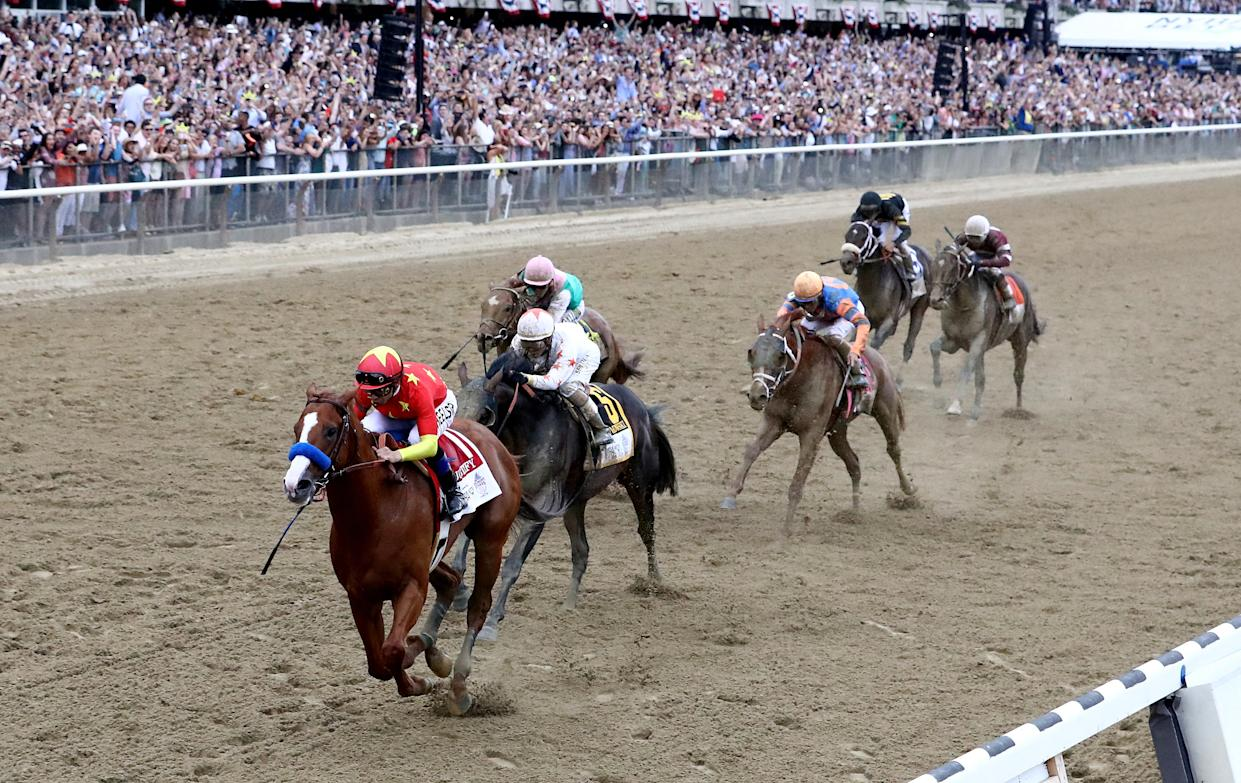 Justify won the 150th running on the Belmont Stakes to complete the 13th Triple Crown in horse racing history. (Getty)
