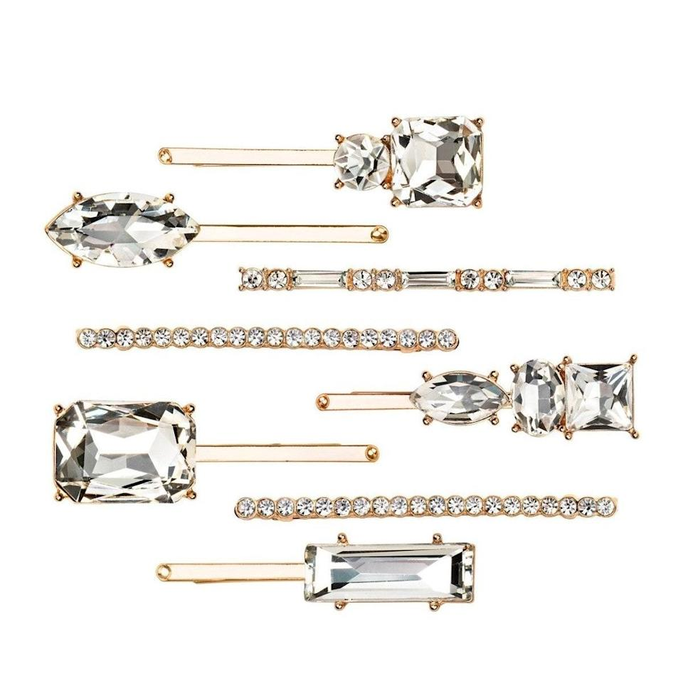 """<p>Why settle for just one when you can have eight stackable rhinestone hair pins from the Kitsch x Justine Marjan's collection to dress up your hairstyle? If your hair is <a href=""""https://www.allure.com/gallery/hairstyles-for-short-hair?mbid=synd_yahoo_rss"""" rel=""""nofollow noopener"""" target=""""_blank"""" data-ylk=""""slk:shorter"""" class=""""link rapid-noclick-resp"""">shorter</a>, """"try slicking all the hair back and placing pins at the back of the head,"""" says Marjan. """"I personally love crisscrossing the bobby pins from ear to ear.""""</p> <p><strong>$29</strong> <strong>for eight</strong> (<a href=""""https://mykitsch.com/collections/kitsch-x-justine-marjan/products/rhinestone-stacker-8pc-set-gold"""" rel=""""nofollow noopener"""" target=""""_blank"""" data-ylk=""""slk:Shop Now"""" class=""""link rapid-noclick-resp"""">Shop Now</a>)</p>"""
