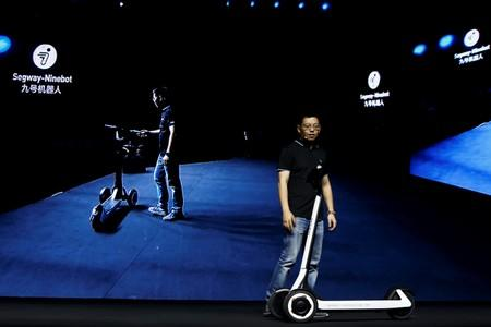 Ninebot President Wang Ye unveils semi-autonomous scooter KickScooter T60 that can return itself to charging stations without a driver, at a Segway-Ninebot product launch event in Beijing