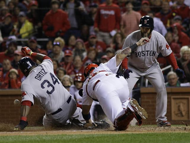 Boston Red Sox Dustin Pedroia, right, watches as David Ortiz slides safely past St. Louis Cardinals catcher Yadier Molina during the fifth inning of Game 4 of baseball's World Series Sunday, Oct. 27, 2013, in St. Louis. Ortiz scored on a sacrifice fly by Stephen Drew. (AP Photo/Matt Slocum)