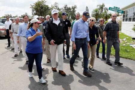 U.S. President Donald Trump (2nd L) and Florida Governor Rick Scott (C) view Hurricane Irma damage to homes in Naples, Florida, U.S. September 14, 2017. REUTERS/Jonathan Ernst