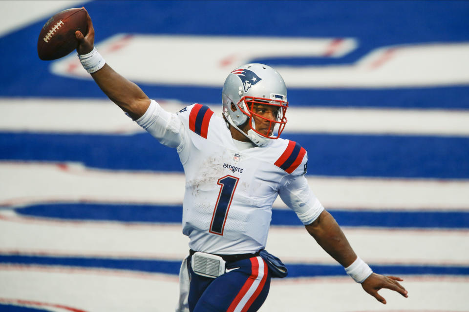 New England Patriots quarterback Cam Newton (1) reacts after rushing for a touchdown during the second half of an NFL football game against the Buffalo Bills Sunday, Nov. 1, 2020, in Orchard Park, N.Y. (AP Photo/John Munson)