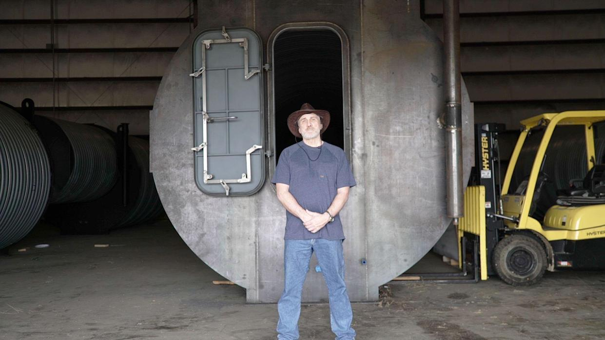 Ron Hubbard in front of a 10 x 36 bunker. (Photo: Yahoo Finance)