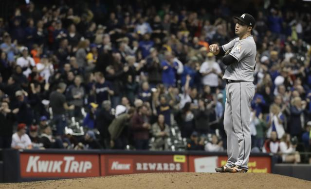 Miami Marlins relief pitcher Junichi Tazawa reacts during the sixth inning of a baseball game against the Milwaukee Brewers Thursday, April 19, 2018, in Milwaukee. The Brewers scored seven runs in the inning. (AP Photo/Morry Gash)