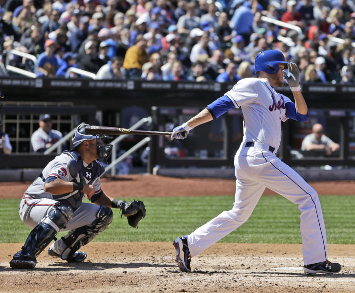 New York Mets' Zack Wheeler drives in a run during the second inning of a baseball game against the Atlanta Braves, Sunday, April 20, 2014 in New York. Wheeler was safe at first on Braves fielding error. (AP Photo/Seth Wenig)