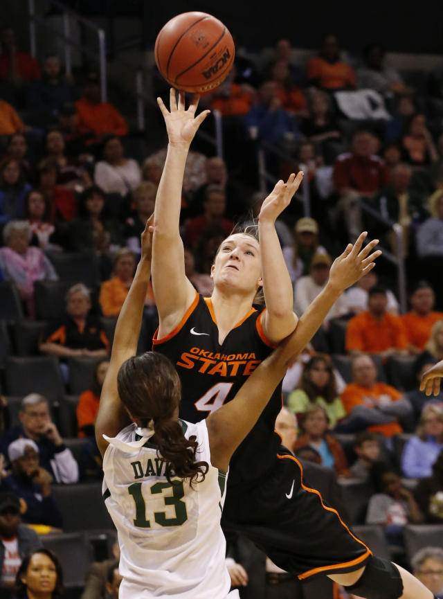 Oklahoma State forward Liz Donohoe (4) is fouled by Baylor forward Nina Davis (13) as she shoots in the second half of an NCAA college basketball game in the semifinals of the Big 12 Conference women's college tournament in Oklahoma City, Sunday, March 9, 2014. Baylor won 65-61. (AP Photo/Sue Ogrocki)