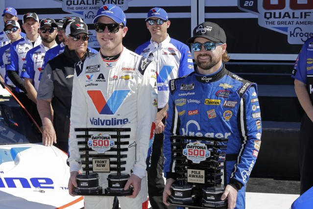 Alex Bowman, front left, and Ricky Stenhouse Jr. hold their trophies after securing the top two starting positions in the Daytona 500 during NASCAR auto race qualifying at Daytona International Speedway, Sunday, Feb. 9, 2020, in Daytona Beach, Fla. (AP Photo/Terry Renna)