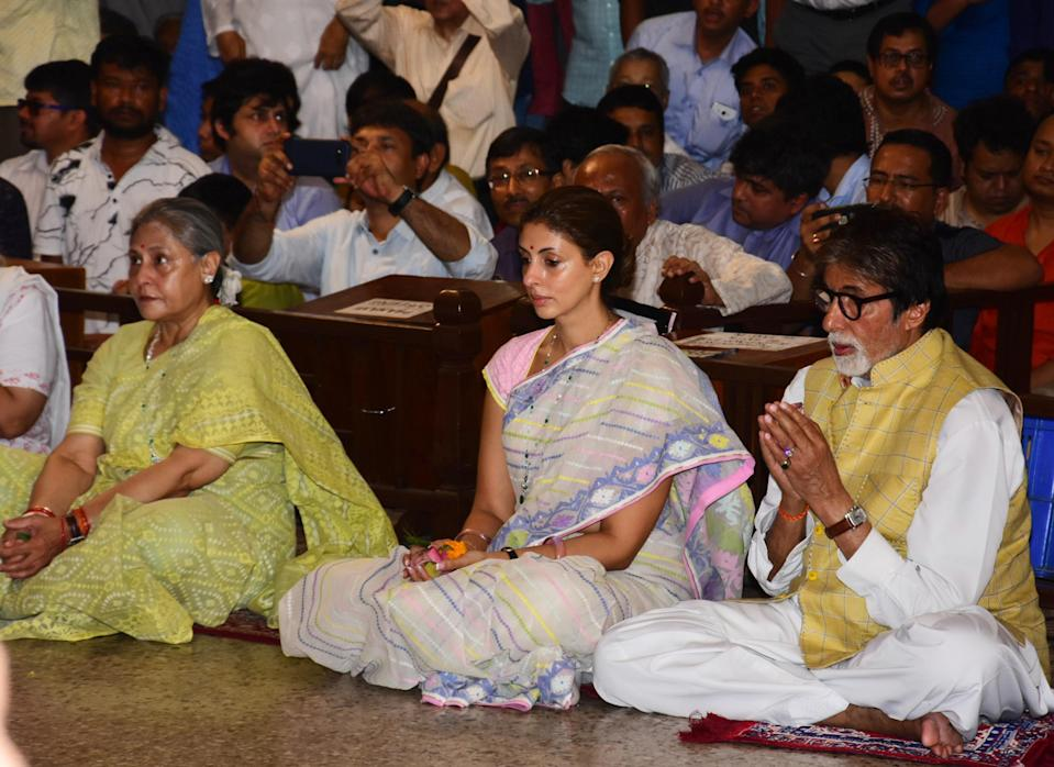 The three Bachchans sit in a moment of prayer.