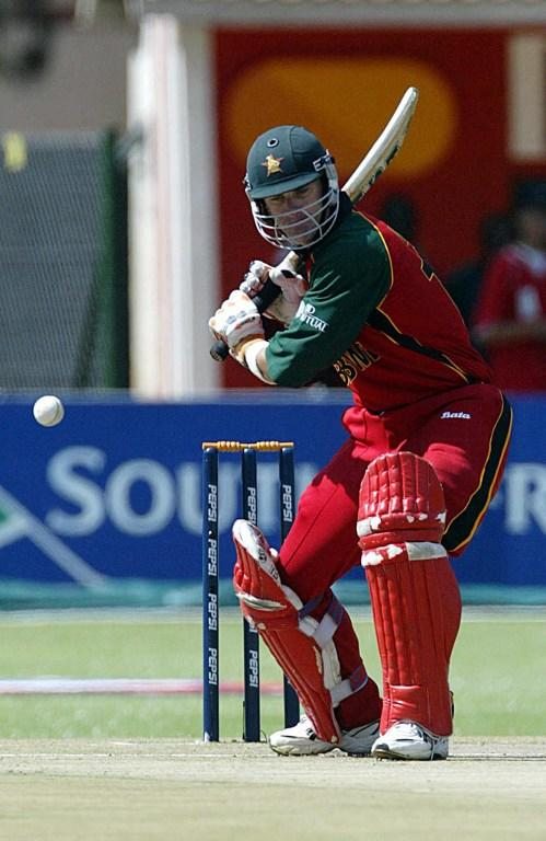 Zimbabwean batsman Craig Wishart IS about to hit a 6 run 10 Februray 2003 at Harare Sports Ground during their first match of the 2003 Cricket World Cup against Naibia in Harare.   AFP PHOTO: Alexander JOE