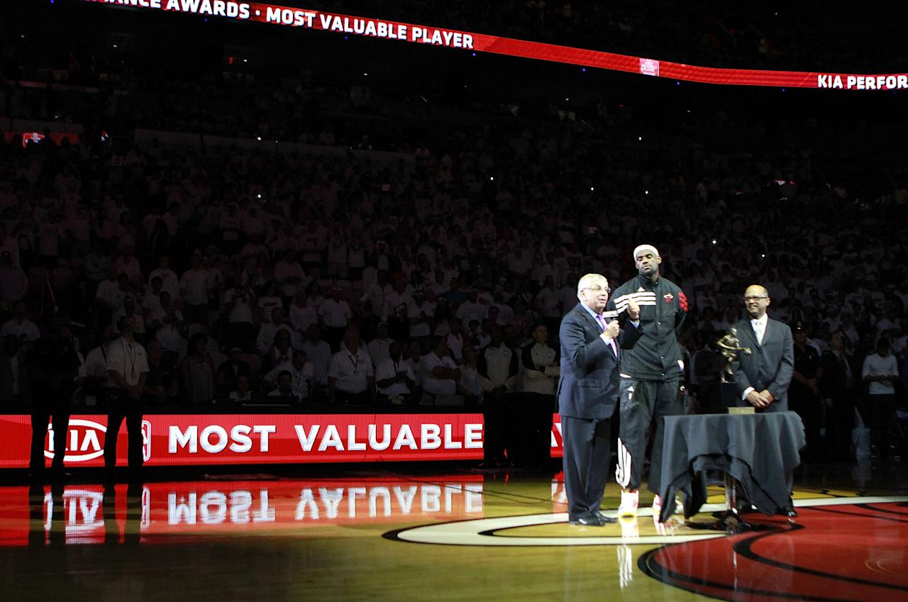 MIAMI, FL - MAY 13:  Forward Lebron James #6 (C)  of the Miami Heat receives the Most Valuable Player  Trophy from Commissioner of the NBA David Stern (L) prior to playing against the Indiana Pacers in Game One of the Eastern Conference Semifinals in the 2012 NBA Playoffs on May 13, 2012 at the American Airines Arena in Miami, Florida. NOTE TO USER: User expressly acknowledges and agrees that, by downloading and or using this photograph, User is consenting to the terms and conditions of the Getty Images License Agreement.  (Photo by Marc Serota/Getty Images)