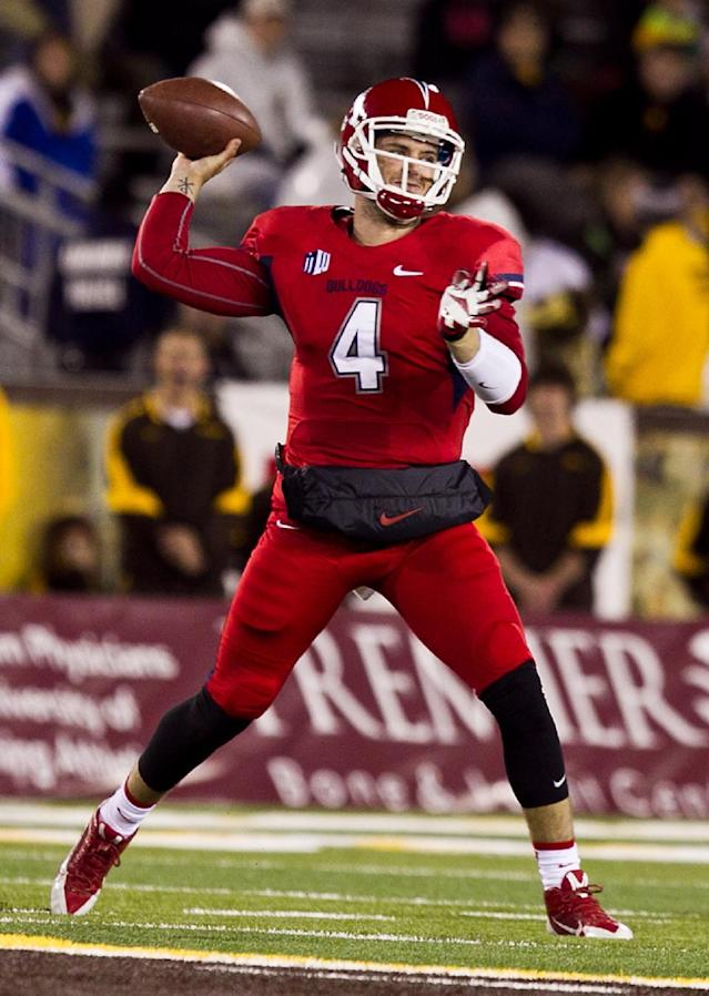 Fresno State quarterback Derek Carr (4) throws a pass past Wyoming Saturday Nov. 9, 213 during the first half of the game at War Memorial Stadium in Laramie, Wyo. (AP Photo/Jeremy Martin)