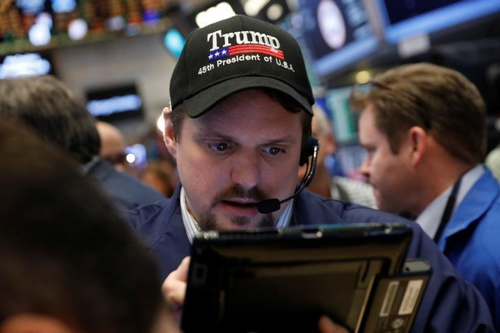 A trader wears a Donald Trump hat while working on the floor of the NYSE shortly after the opening bell in New York