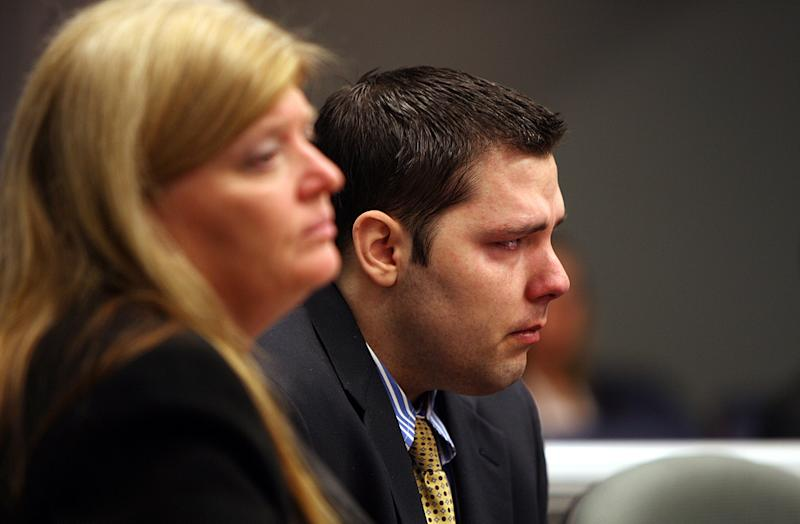 Army Sgt. Anthony Peden listens to a Long County court, Thursday, May 1, 2014, in Ludowici, Ga. Peden was sentenced to life in prison Thursday by a southeast Georgia judge for the December 2011 slayings of 17-year-old Tiffany York and her boyfriend, former soldier Michael Roark. (AP Photo/Lewis Levine)