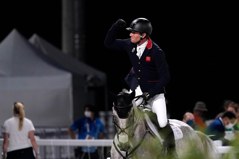 Britain's Oliver Townend, riding Ballaghmor Class, celebrates after competing during the equestrian eventing jumping at Equestrian Park in Tokyo (AP)
