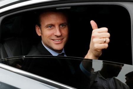 Emmanuel Macron, head of the political movement En Marche ! (Onwards !) and a candidate for the 2017 presidential election, leaves the Paris book fair