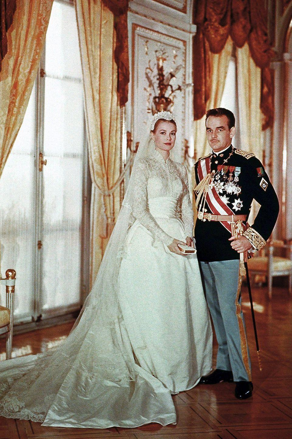 """<p>Talk about fit for a princess! One of the most iconic and elegant bridal gowns of all time, Grace Kelly's dress was so influential that even Kate Middleton reportedly took inspiration from it. Worn during her wedding to Prince Rainier III of Monaco, it was also designed by Helen Rose.</p><p><strong>RELATED</strong>: <a href=""""https://www.goodhousekeeping.com/beauty/fashion/g4719/grace-kelly-wedding-gown/"""" rel=""""nofollow noopener"""" target=""""_blank"""" data-ylk=""""slk:10 Hidden Details You Didn't Know About Grace Kelly's Wedding Dress"""" class=""""link rapid-noclick-resp"""">10 Hidden Details You Didn't Know About Grace Kelly's Wedding Dress</a></p>"""