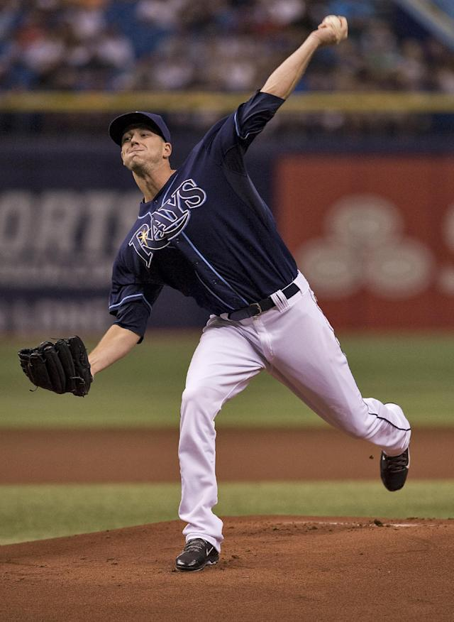 Tampa Bay Rays starter Drew Smyly pitches against the New York Yankees during the first inning of a baseball game Saturday, Aug. 16, 2014, in St. Petersburg, Fla. (AP Photo/Steve Nesius)
