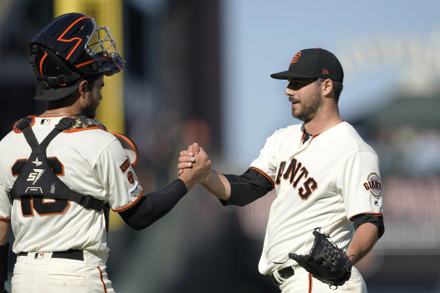 San Francisco Giants catcher Aramis Garcia (16) congratulates pitcher Kyle Barraclough after the team's 8-3 victory against the Colorado Rockies in a baseball game Thursday, Sept. 26, 2019, in San Francisco. (AP Photo/Tony Avelar)
