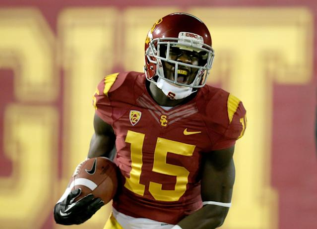 LOS ANGELES, CA - OCTOBER 10: Wide receiver Nelson Agholor #15 of the USC Trojans celebrates after scoring on a 62 yard touchdown pass play in the first quarter against the Arizona Wildcats at Los Angeles Coliseum on October 10, 2013 in Los Angeles, California. (Photo by Stephen Dunn/Getty Images)