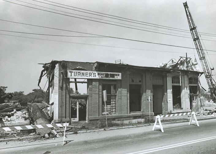 File Photo from July 8, 1979 shows businesses being torn down, in the Hayti business district to make room for the East-West Expressway.