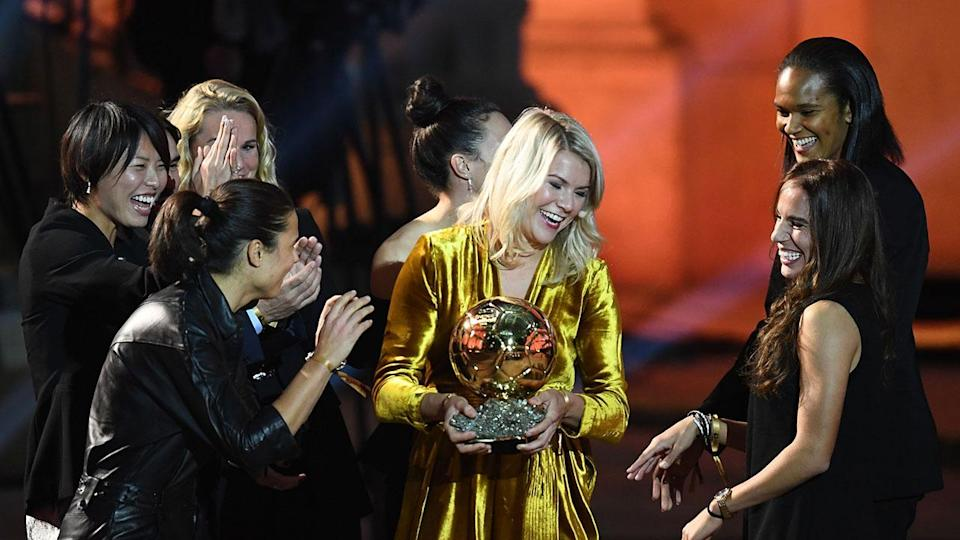 Hegerberg is congratulated by her peers after winning the women's Ballon d'Or. Pic: Getty