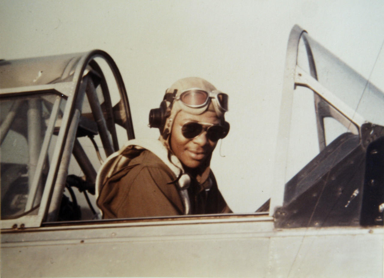 In this undated handout photo provided by George Hickman, Hickman is shown in the cockpit of an AT-6 trainer airplane in Tuskegee, Ala. Hickman, one of the original Tuskegee Airmen, died Sunday, Aug. 19, 2012, in Seattle. He was 88. (AP Photo/Courtesy George Hickman, file)