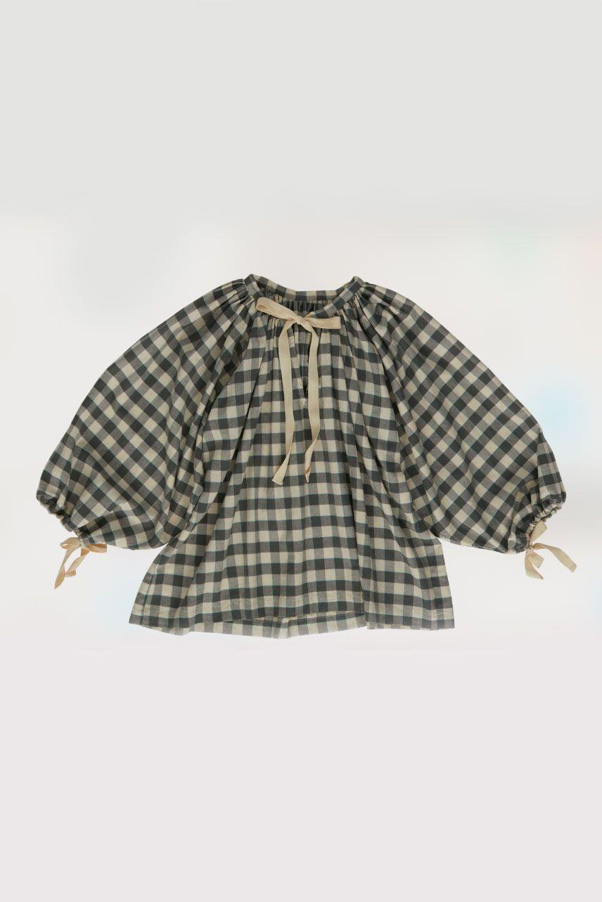 """<p><a class=""""link rapid-noclick-resp"""" href=""""https://www.renlondon.co/all/delphine-tunic-gingham"""" rel=""""nofollow noopener"""" target=""""_blank"""" data-ylk=""""slk:SHOP NOW"""">SHOP NOW</a></p><p>Sustainable brand Ren London is a go-to for thoughtfully designed, ethical clothing. Its voluminous tunic top, made from handwoven Indian cotton, is a way of approaching gingham with a hint of bohemia. </p><p>Delphine tunic, £195, <a href=""""https://www.renlondon.co/all/delphine-tunic-gingham"""" rel=""""nofollow noopener"""" target=""""_blank"""" data-ylk=""""slk:Ren London"""" class=""""link rapid-noclick-resp"""">Ren London</a></p>"""