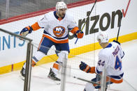 New York Islanders' Kyle Palmieri (21) celebrates with Jean-Gabriel Pageau (44) after scoring during the first period in Game 1 of an NHL hockey Stanley Cup first-round playoff series against the Pittsburgh Penguins in Pittsburgh, Sunday, May 16, 2021. (AP Photo/Gene J. Puskar)