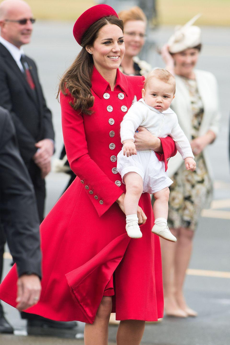 "<p>Flawless in <a href=""https://www.harpersbazaar.com/celebrity/red-carpet-dresses/g3827/kate-middleton-princess-diana-photos/"" rel=""nofollow noopener"" target=""_blank"" data-ylk=""slk:an all-red look"" class=""link rapid-noclick-resp"">an all-red look</a>, Duchess Kate arrives holding Prince George in New Zealand.</p>"