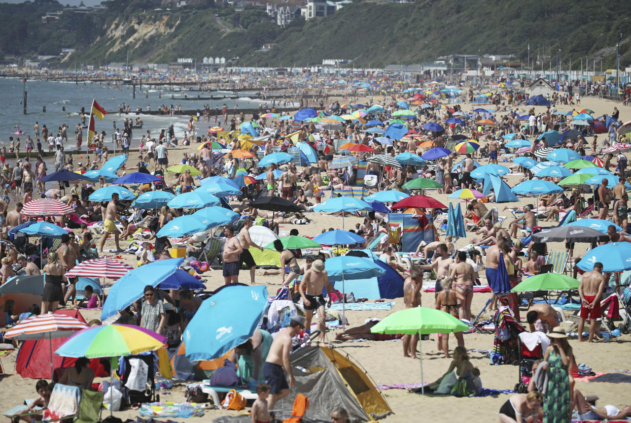 People flocked to the beach to enjoy the hot weather on Saturday (Picture: Andrew Matthews/PA via AP)