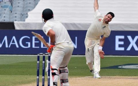 England's James Anderson, right, bowls to Australia's David Warner during the fourth day of their Ashes cricket test match in Melbourne, Australia, Friday, Dec. 29, 2017 - Credit: AP