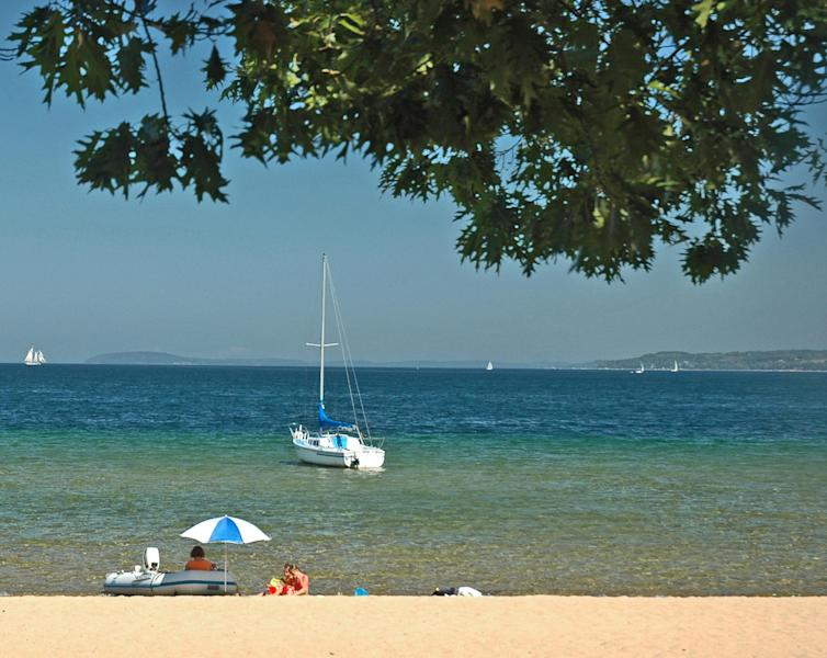 This undated photo released by the Traverse City Convention & Visitors Bureau shows West End Beach in Traverse City, one of many free-of-charge beaches on Lake Michigan's Grand Traverse Bay. (AP Photo/Traverse City Convention & Visitors Bureau)