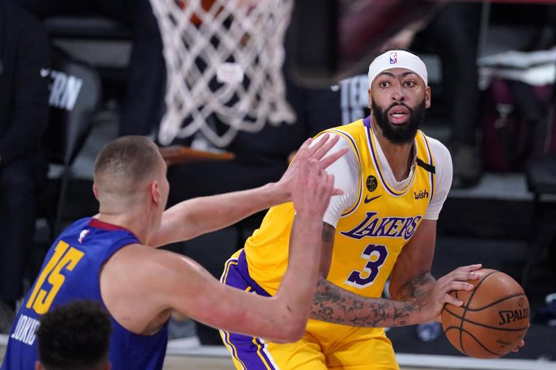 Denver Nuggets' Nikola Jokic (15) defends as Los Angeles Lakers forward Anthony Davis (3) looks for a shot opportunity during the second half an NBA conference final playoff basketball game, Friday, Sept. 18, 2020, in Lake Buena Vista, Fla. (AP Photo/Mark J. Terrill)