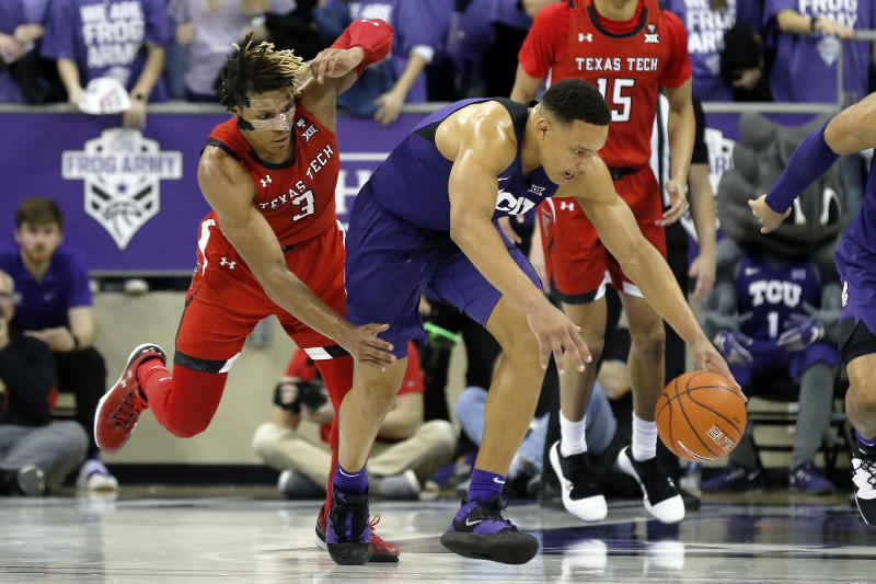 TCU guard Desmond Bane, center, makes the steal on Texas Tech guard Jahmi'us Ramsey, left, during the second half of an NCAA college basketball game in Fort Worth, Texas, Tuesday, Jan. 21, 2020. TCU won 65-54. (AP Photo/Ray Carlin)