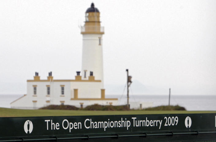 FILE - This July 2, 2009, file photo, shows the Turnberry Lighthouse on the Ailsa Course at the Turnberry golf course in Scotland. Trump is returning to a family business ravaged by pandemic shutdowns, with revenue plunging more than 40 percent at his Doral golf property, his Washington hotel and at both his Scottish resorts. Trump's financial disclosure released as he left office this week was just the latest bad news for his financial empire after banks, brokerages and golf organizations announced they were cutting ties with his company following the storming of the Capitol this month by his political supporters (AP Photo/Scott Heppell, File)