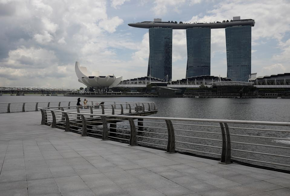 People take photos at Merlion Park in Singapore.