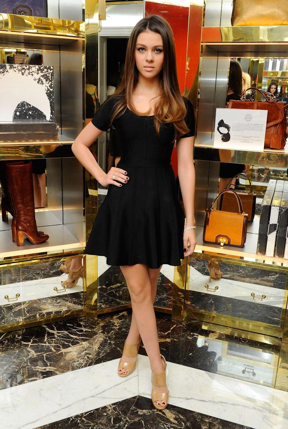 <p>A young, brunette Peltz donned a black mini dress with beige heeled sandals for a night out in the Big Apple. </p>